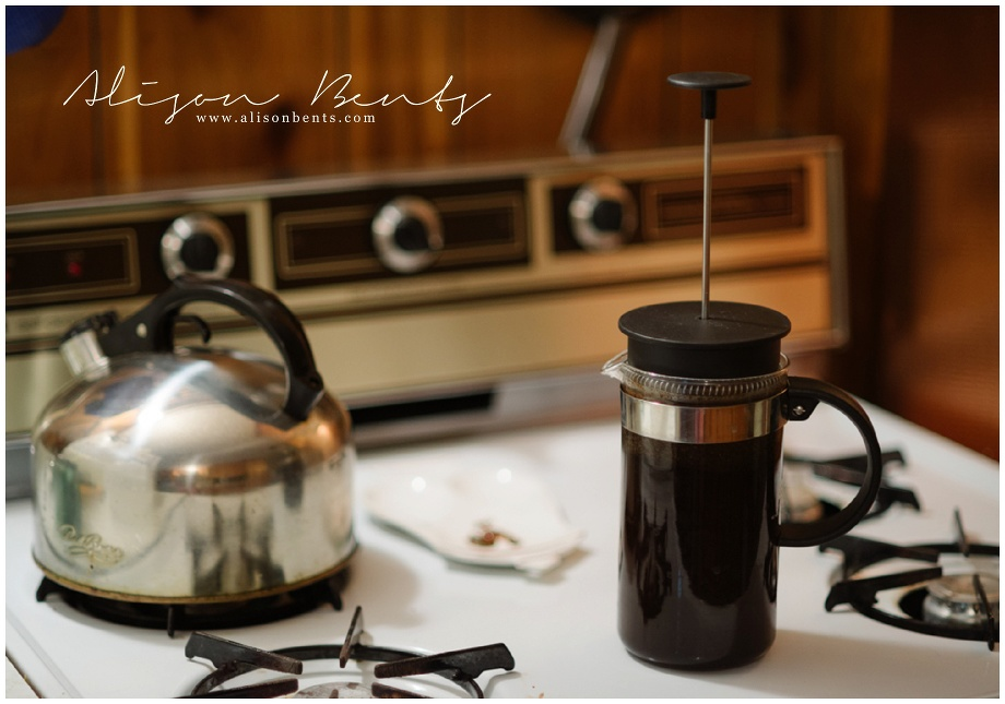 french press on stove with kettle