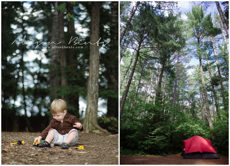 boy playing with trucks in woods, tent among trees