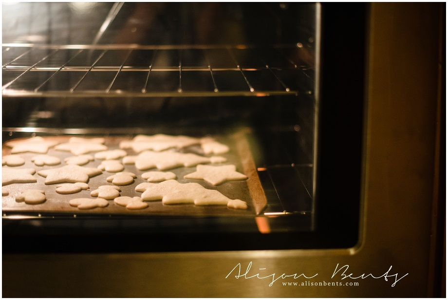 christmas cookies baking in an oven